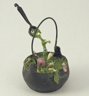 Witch's cauldron with floating ladle by Linda Cummings.