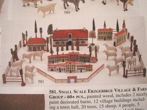 Vintage toy Erzgebirge village set in an auction catalog.