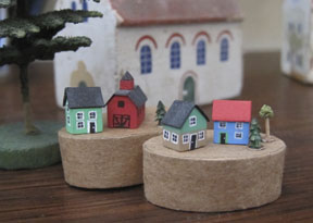 """Miniature Erzgebirge buildings (houses are approximately 1/4"""" wide) in front of a vintage toy Erzgebirge church."""