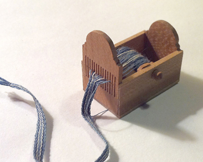 Box-Style Tape Loom in 1/12 scale by Bonni Backe of Weevings. Class project, Guild School 2012.