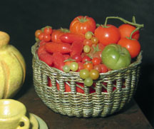 1/12 scale basket of tomatoes by Silvia Cucchi, Artisan member.