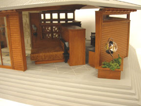 A 1:48 scale house in the Frank Lloyd Wright style by new Artisan Carol Silberman.