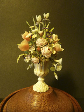 IGMA Artisan member Peter Gabel's prize winning miniature floral arrangement, all done in shells!