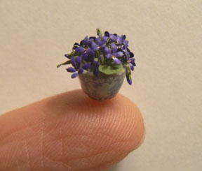 A tiny pot of violets by Artisan member Peter Gabel.