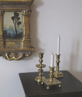 Turned brass candlesticks in 1/12 scale by IGMA Artisan members Julie Stevens and Bill Robertson.
