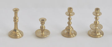 A row of 1/12 scale brass candlesticks turned by Artisan member Julie Stevens of Silver Beak Studio.