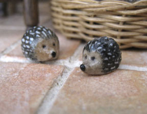 Porcelain hedgehogs in 1/12 scale by Artisan member Julie Stevens, keeping the kitchens free from insects.