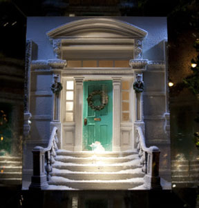 A miniature version of their signature blue boxes rests on the steps of this iconic NYC brownstone in the holiday windows of Tiffany's. Photo by Jessica Lin of Timeout.com.