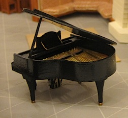 A grand piano in quarter scale by Carol  Silberman.