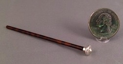 Lathe turned walking stick with silver knob in 1/12 scale by Julie Stevens.