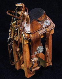 A 1/12 scale saddle, complete with conch decoration by Deb Mackie of White Horse Studio.