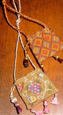 Two sweet bags in 1/12 scale with hand braided cord trim.