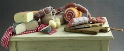 A feast of cheese and salami  in 1/12 scale by Christina Minischetti.
