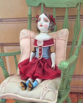 A fully jointed doll by Gale Elena Bantock.
