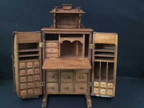 A Wooten desk with its plethora of drawers and compartments by Jim Gans.
