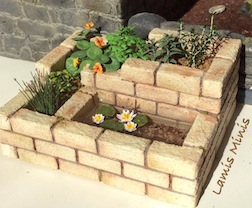A spiral garden in 1/12 scale by IGMA member Pia Becker of Lamis Minis.