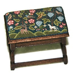 An 18th century style pillow by Annelle Ferguson atop a footstool by Mark Murphy. Annelle will be a dealer at the show and Mark will have pieces at the Gallery table.