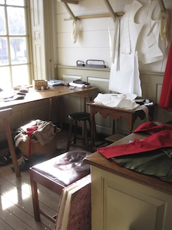 The tailor's work area in the millinery shop in Colonial Williamsburg.