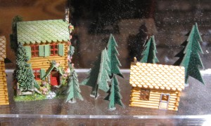General member and dealer Ruth Stewart of Stewart Dollhouse Creations specializes in kits to make many wonderful dollhouse miniatures including these tiny log cabin kits.