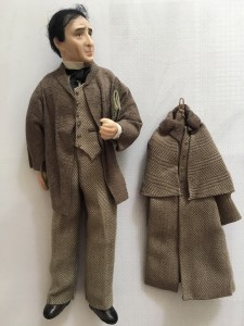 A quizzical Sherlock Holmes, a porcelain doll created by IGMA Fellow member Shirley Whitworth, who is now retired.